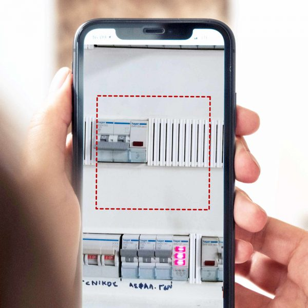 smartphone scanning electrical distribution box